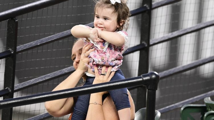 May 19, 2021; Baltimore, Maryland, USA;  A mother and child cheer during the game between the Baltimore Orioles and the Tampa Bay Rays at Oriole Park at Camden Yards. Mandatory Credit: Tommy Gilligan-USA TODAY Sports