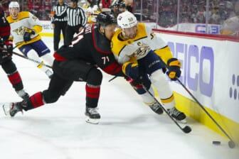 May 19, 2021; Raleigh, North Carolina, USA; Nashville Predators defenseman Roman Josi (59) skates with the puck against Carolina Hurricanes right wing Jesper Fast (71) during the first period in game two of the first round of the 2021 Stanley Cup Playoffs at PNC Arena. Mandatory Credit: James Guillory-USA TODAY Sports