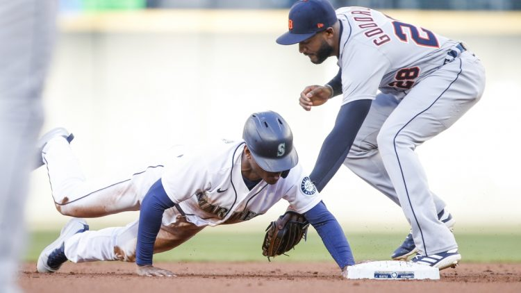 May 19, 2021; Seattle, Washington, USA; Seattle Mariners center fielder Kyle Lewis (1) steals second base against Detroit Tigers shortstop Niko Goodrum (28) during the first inning at T-Mobile Park. Mandatory Credit: Joe Nicholson-USA TODAY Sports