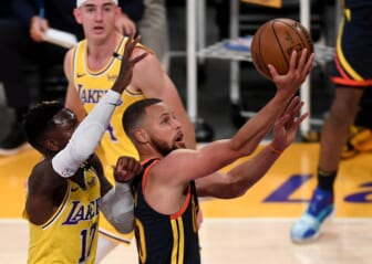 May 19, 2021; Los Angeles, California, USA;   Golden State Warriors guard Stephen Curry (30) gets past Los Angeles Lakers guard Dennis Schroder (17) and Los Angeles Lakers guard Alex Caruso (4) as he drives to the basket in the first half of the game at Staples Center. Mandatory Credit: Jayne Kamin-Oncea-USA TODAY Sports