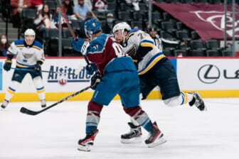 May 19, 2021; Denver, Colorado, USA; Colorado Avalanche center Nazem Kadri (91) checks St. Louis Blues defenseman Justin Faulk (72) in the third period in game two of the first round of the 2021 Stanley Cup Playoffs at Ball Arena. Kadri would be ejected from the game for an illegal hit to the head. Mandatory Credit: Isaiah J. Downing-USA TODAY Sports