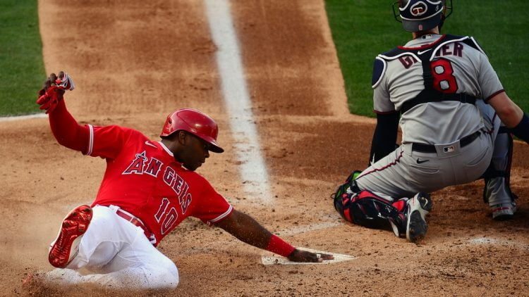 May 20, 2021; Anaheim, California, USA; Los Angeles Angels left fielder Justin Upton (10) scores a run ahead of Minnesota Twins catcher Mitch Garver (8) during the second inning at Angel Stadium. Mandatory Credit: Gary A. Vasquez-USA TODAY Sports