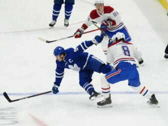 May 20, 2021; Toronto, Ontario, CAN; Toronto Maple Leafs forward John Tavares (91) is hit by Montreal Canadiens defenseman Ben Chiarot (8) during the first period of game one of the first round of the 2021 Stanley Cup Playoffs at Scotiabank Arena. Mandatory Credit: John E. Sokolowski-USA TODAY Sports