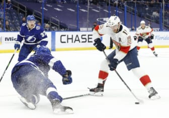 May 20, 2021; Tampa, Florida, USA; Florida Panthers left wing Jonathan Huberdeau (11) shoots the puck as Tampa Bay Lightning defenseman Erik Cernak (81) defends the shot during the second period in game three of the first round of the 2021 Stanley Cup Playoffs at Amalie Arena. Mandatory Credit: Kim Klement-USA TODAY Sports