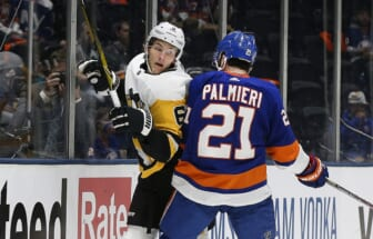 May 20, 2021; Uniondale, New York, USA; Pittsburgh Penguins defenseman John Marino (6) is checked into the boards by New York Islanders left wing Kyld Palmieri (21) during the second period in game three of the first round of the 2021 Stanley Cup Playoffs at Nassau Veterans Memorial Coliseum. Mandatory Credit: Andy Marlin-USA TODAY Sports