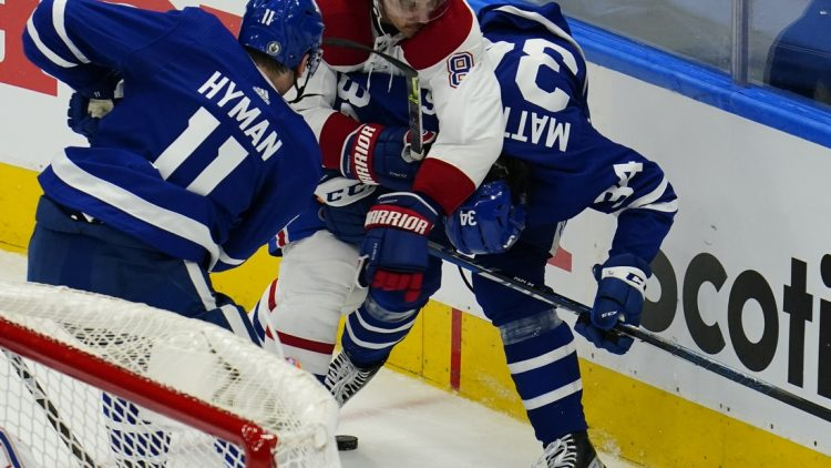 May 20, 2021; Toronto, Ontario, CAN; Montreal Canadiens defenseman Ben Chiarot (8) roughs up Toronto Maple Leafs forward Auston Matthews (34) during the second period of game one of the first round of the 2021 Stanley Cup Playoffs at Scotiabank Arena. Mandatory Credit: John E. Sokolowski-USA TODAY Sports