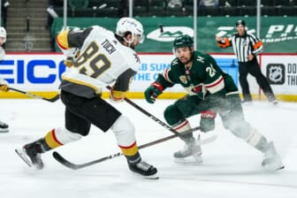 May 20, 2021; Saint Paul, Minnesota, USA; Minnesota Wild defenseman Matt Dumba (24) blocks a shot from Vegas Golden Knights forward Alex Tuch (89) during the first period in game three of the first round of the 2021 Stanley Cup Playoffs at Xcel Energy Center. Mandatory Credit: Brace Hemmelgarn-USA TODAY Sports