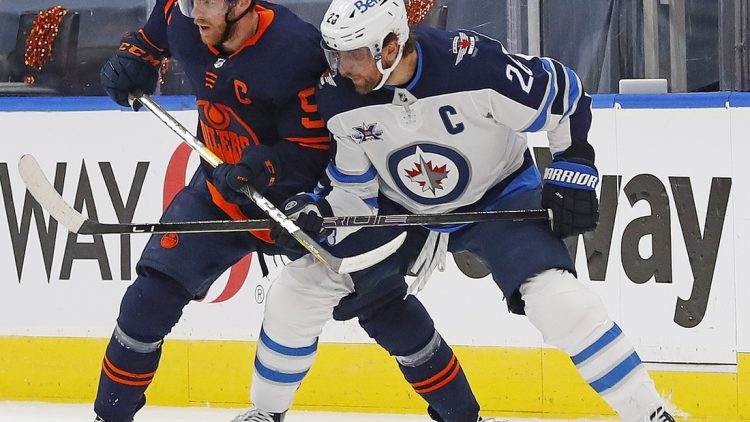 May 21, 2021; Edmonton, Alberta, CAN; Edmonton Oilers forward Connor McDavid (97) and Winnipeg Jets forward Blake Wheeler (26) battle for position during the first period in game two of the first round of the 2021 Stanley Cup Playoffs at Rogers Place. Mandatory Credit: Perry Nelson-USA TODAY Sports