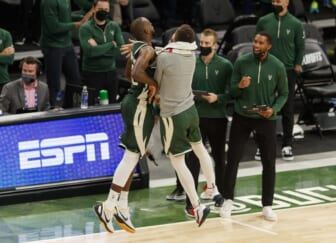 May 22, 2021; Milwaukee, Wisconsin, USA;  Milwaukee Bucks forward Khris Middleton (22) celebrates after making a basket during overtime against the Miami Heat during game one in the first round of the 2021 NBA Playoffs at Fiserv Forum. Mandatory Credit: Jeff Hanisch-USA TODAY Sports