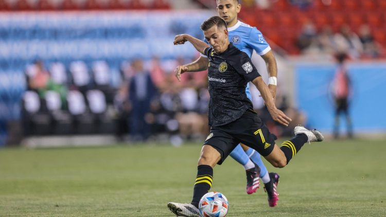 May 22, 2021; Harrison, New Jersey, USA; Columbus Crew forward Pedro Santos (7) kicks the ball against New York City FC during the first half at Red Bull Arena. Mandatory Credit: Vincent Carchietta-USA TODAY Sports