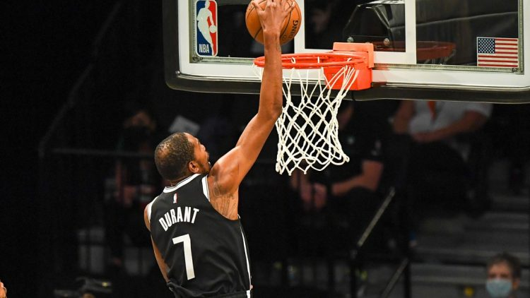 May 22, 2021; Brooklyn, New York, USA;  Brooklyn Nets forward Kevin Durant (7) dunks the ball against the Boston Celtics during the second quarter of game one in the first round of the 2021 NBA Playoffs. at Barclays Center. Mandatory Credit: Dennis Schneidler-USA TODAY Sports