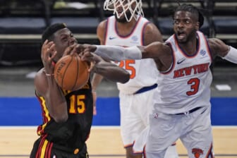 May 23, 2021; New York, New York, USA; New York Knicks center Nerlens Noel (3) fouls Atlanta Hawks center Clint Capela (15) during the second half in game one in the first round of the 2021 NBA Playoffs at Madison Square Garden. Mandatory Credit: Seth Wenig/Pool Photo-USA TODAY Sports