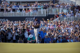 May 23, 2021; Kiawah Island, South Carolina, USA; Phil Mickelson checks his notes before putting on the 18th green during the final round of the PGA Championship golf tournament. Mandatory Credit: Geoff Burke-USA TODAY Sports