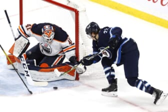 May 23, 2021; Winnipeg, Manitoba, CAN; Winnipeg Jets center Mason Appleton (22) shoots on Edmonton Oilers goaltender Mike Smith (41) int the second period in game three of the first round of the 2021 Stanley Cup Playoffs at Bell MTS Place. Mandatory Credit: James Carey Lauder-USA TODAY Sports