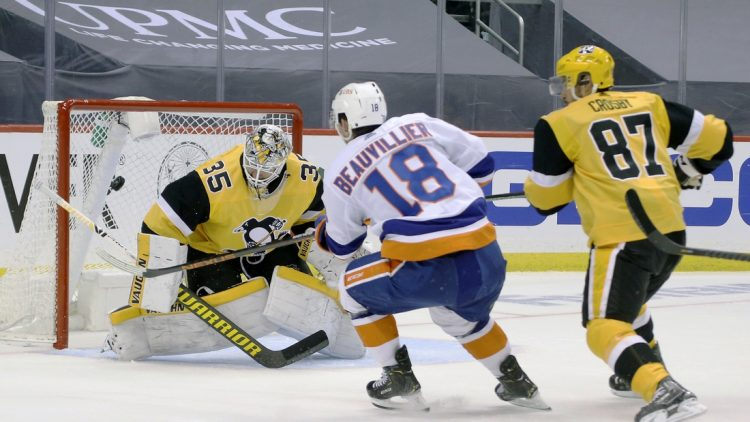 May 24, 2021; Pittsburgh, Pennsylvania, USA; New York Islanders left wing Anthony Beauvillier (18) scores a goal against Pittsburgh Penguins goaltender Tristan Jarry (35) as center Sidney Crosby (87) defends during the first period in game five of the first round of the 2021 Stanley Cup Playoffs at PPG Paints Arena. Mandatory Credit: Charles LeClaire-USA TODAY Sports