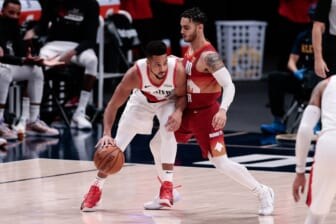 May 24, 2021; Denver, Colorado, USA; Portland Trail Blazers guard CJ McCollum (3) controls the ball as Denver Nuggets guard Markus Howard (00) guards in the second quarter during game two in the first round of the 2021 NBA Playoffs at Ball Arena. Mandatory Credit: Isaiah J. Downing-USA TODAY Sports