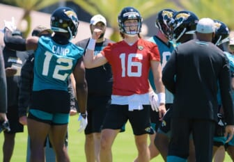 Jaguars quarterback Trevor Lawrence (16) talks with teammates during drills at rookie minicamp.Jki 051521 Jaguarsrookiecamp 05