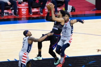 May 26, 2021; Philadelphia, Pennsylvania, USA; Philadelphia 76ers forward Tobias Harris (12) moves to the basket against Washington Wizards guard Bradley Beal (3) and forward Rui Hachimura (8) during the first quarter of game two in the first round of the 2021 NBA Playoffs at Wells Fargo Center. Mandatory Credit: Bill Streicher-USA TODAY Sports