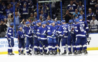 May 26, 2021; Tampa, Florida, USA;Tampa Bay Lightning right wing Barclay Goodrow (19) and teammates  celebrate as they beat the Florida Panthers during game six of the first round of the 2021 Stanley Cup Playoffs at Amalie Arena. Mandatory Credit: Kim Klement-USA TODAY Sports