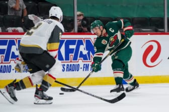 May 26, 2021; Saint Paul, Minnesota, USA; Minnesota Wild defenseman Jared Spurgeon (46) shoots against Vegas Golden Knights defenseman Zach Whitecloud (2) in the second period in game six of the first round of the 2021 Stanley Cup Playoffs at Xcel Energy Center. Mandatory Credit: Brad Rempel-USA TODAY Sports