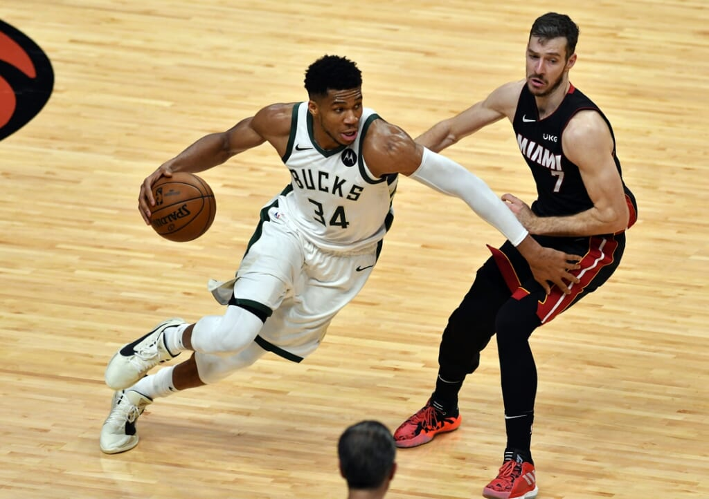 May 27, 2021; Miami, Florida, USA; Milwaukee Bucks forward Giannis Antetokounmpo (34) drives past Miami Heat guard Goran Dragic (7) in the second half during game three in the first round of the 2021 NBA Playoffs at American Airlines Arena. Mandatory Credit: Jim Rassol-USA TODAY Sports
