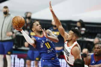 May 27, 2021; Portland, Oregon, USA; Denver Nuggets point guard Monte Morris (11) shoots the ball against Portland Trail Blazers shooting guard CJ McCollum (3) during the first half of game three in the first round of the 2021 NBA Playoffs at Moda Center. Mandatory Credit: Soobum Im-USA TODAY Sports