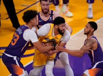 May 27, 2021; Los Angeles, California, USA; Los Angeles Lakers forward Anthony Davis (3) is surrounded by Phoenix Suns forward Cameron Johnson (23), forward Frank Kaminsky (8) and guard Cameron Payne (15) during the fourth quarter of game three in the first round of the 2021 NBA Playoffs at Staples Center. Mandatory Credit: Robert Hanashiro-USA TODAY Sports