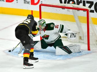 May 28, 2021; Las Vegas, Nevada, USA; Vegas Golden Knights center Mattias Janmark (26) scores a first period goal against Minnesota Wild goaltender Cam Talbot (33) in game seven of the first round of the 2021 Stanley Cup Playoffs at T-Mobile Arena. Mandatory Credit: Stephen R. Sylvanie-USA TODAY Sports