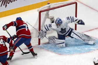 May 29, 2021; Montreal, Quebec, CAN; Montreal Canadiens right wing Tyler Toffoli (73) plays the puck next to Toronto Maple Leafs goaltender Jack Campbell (36) during the first period in game six of the first round of the 2021 Stanley Cup Playoffs at Bell Centre. Mandatory Credit: Jean-Yves Ahern-USA TODAY Sports