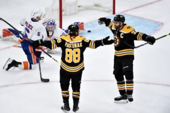 May 29, 2021; Boston, MA, USA; Boston Bruins right wing David Pastrnak (88) reacts with center Patrice Bergeron (37) after scoring his second goal of the game during the second period in game one of the second round of the 2021 Stanley Cup Playoffs against the New York Islanders at TD Garden. Mandatory Credit: Bob DeChiara-USA TODAY Sports