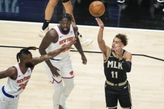 May 30, 2021; Atlanta, Georgia, USA; Atlanta Hawks guard Trae Young (11) shoots over New York Knicks forward Reggie Bullock (25) during the first quarter in game four in the first round of the 2021 NBA Playoffs at State Farm Arena. Mandatory Credit: Dale Zanine-USA TODAY Sports