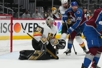 May 30, 2021; Denver, Colorado, USA; Vegas Golden Knights goaltender Robin Lehner (90) defends his net from left wing Brandon Saad (20) in the first period of game one in the second round of the 2021 Stanley Cup Playoffs at Ball Arena. Mandatory Credit: Ron Chenoy-USA TODAY Sports