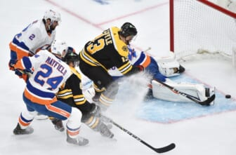 May 31, 2021; Boston, Massachusetts, USA; Boston Bruins center Charlie Coyle (13) scores a goal past New York Islanders goaltender Semyon Varlamov (40) during the first period in game two of the second round of the 2021 Stanley Cup Playoffs at TD Garden. Mandatory Credit: Bob DeChiara-USA TODAY Sports