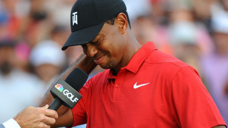 Sep 23, 2018; Atlanta, GA, USA;  Tiger Woods answers questions during a post round interview following the final round of the Tour Championship golf tournament at East Lake Golf Club. Mandatory Credit: Christopher Hanewinckel-USA TODAY Sports