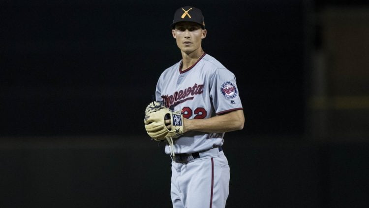 Minnesota Twins pitching prospect Griffin Jax looks for a signal while pitching against the Scottsdale Scorpions in the Arizona Fall League Thursday Oct. 24, 2018, in Scottsdale Ariz. Darryl Webb/For the Republic  Twins pitching prospect Griffin Jax looks for a signal during an Arizona Fall League game against the Scottsdale Scorpions.  Griffin Jax 102518 016