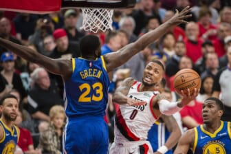 May 20, 2019; Portland, OR, USA; Portland Trail Blazers guard Damian Lillard (0) puts up a shot against Golden State Warriors forward Draymond Green (23) during the second half in game four of the Western conference finals of the 2019 NBA Playoffs at Moda Center. The Warriors won 119-117 in overtime. Mandatory Credit: Troy Wayrynen-USA TODAY Sports