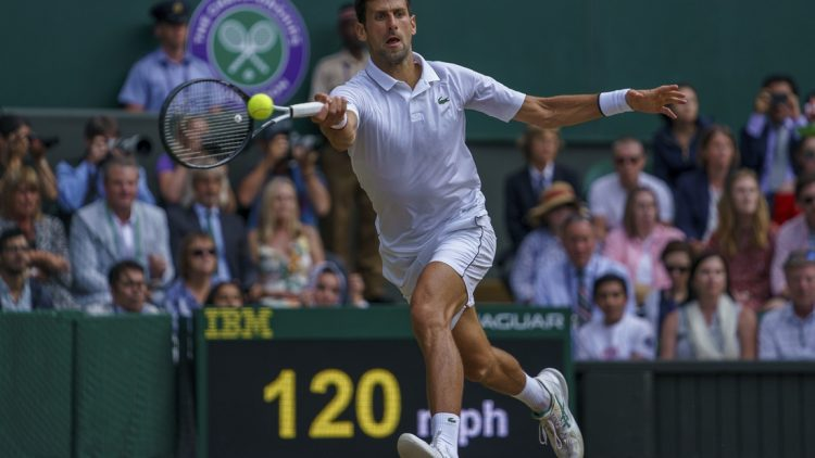 Jul 14, 2019; London, United Kingdom; Novak Djokovic (SRB) in action during the mens final match against Roger Federer (SUI) on day 13 at the All England Lawn and Croquet Club. Mandatory Credit: Susan Mullane-USA TODAY Sports