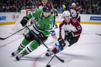 Nov 5, 2019; Dallas, TX, USA; Dallas Stars center Jason Dickinson (18) and Colorado Avalanche center Jayson Megna (12) chase the puck during the second period at the American Airlines Center. Mandatory Credit: Jerome Miron-USA TODAY Sports