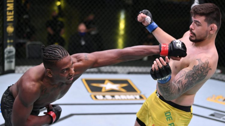 May 30, 2020; Las Vegas, NV, USA; Jamahal Hill (red gloves) punches Klidson Abreu of Brazil (blue gloves) in their light heavyweight fight during UFC Fight Night.  Mandatory Credit: Jeff Bottari/Zuffa via USA TODAY Sports