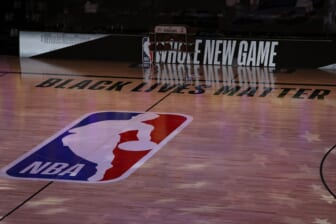July 30, 2020; Lake Buena Vista, USA;  A general view the court with Black Lives Matter written above the NBA logo is seen at center court prior to the game between the LA Clippers and the Los Angeles Lakers at The Arena at ESPN Wide World Of Sports Complex. Mandatory Credit: Mike Ehrmann/Pool Photo via USA TODAY Sports