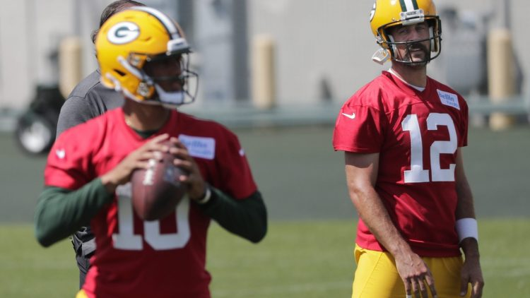 Green Bay Packers quarterback Aaron Rodgers (12) and quarterback Jordan Love (10) are shown Monday, August 17, 2020, during training camp in Green Bay, Wis.Apc Packerstrainingcamp 0817201049