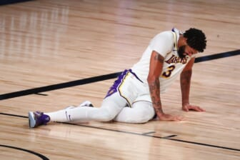 Sep 8, 2020; Lake Buena Vista, Florida, USA; Los Angeles Lakers forward Anthony Davis (3) lies on the floor after suffering an apparent injury with Houston Rockets forward Robert Covington (not picture) during the second half of game three in the second round of the 2020 NBA Playoffs at AdventHealth Arena. Mandatory Credit: Kim Klement-USA TODAY Sports