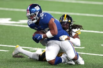 Sep 14, 2020; East Rutherford, New Jersey, USA; New York Giants running back Saquon Barkley (26) is tackled by Pittsburgh Steelers strong safety Terrell Edmunds (34) during the second half at MetLife Stadium. Mandatory Credit: Vincent Carchietta-USA TODAY Sports