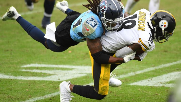 Oct 25, 2020; Nashville, Tennessee, USA; Pittsburgh Steelers wide receiver Diontae Johnson (18) is tackled by Tennessee Titans cornerback Tye Smith (23) after a reception during the second half at Nissan Stadium. Mandatory Credit: Christopher Hanewinckel-USA TODAY Sports