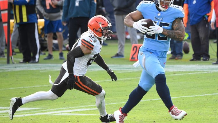 Tennessee Titans tight end MyCole Pruitt (85) rushes for a touchdown after a catch over Cleveland Browns free safety Andrew Sendejo (23) during the third quarter at Nissan Stadium Sunday, Dec. 6, 2020 in Nashville, Tenn.  Gw54480
