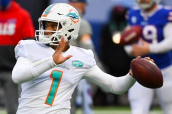 Jan 3, 2021; Orchard Park, New York, USA; Miami Dolphins quarterback Tua Tagovailoa (1) warms up prior to the game against the Buffalo Bills at Bills Stadium. Mandatory Credit: Rich Barnes-USA TODAY Sports
