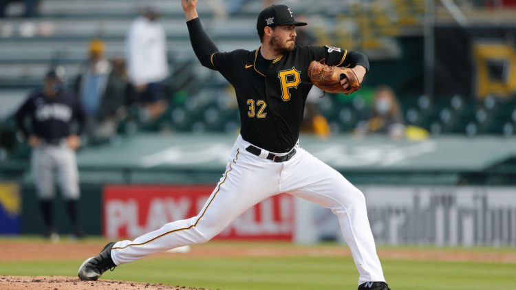 5Mar 6, 2021; Bradenton, Florida, USA;  Pittsburgh Pirates relief pitcher Geoff Hartlieb (32) pitches the fourth inning during spring training at LECOM Park. Mandatory Credit: Nathan Ray Seebeck-USA TODAY Sports