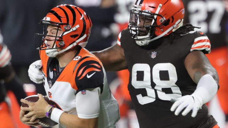 Cleveland Browns defensive tackle Sheldon Richardson (98) sacks Cincinnati Bengals quarterback Joe Burrow (9) during the first half of an NFL football game at FirstEnergy Stadium, Thursday, Sept. 17, 2020, in Cleveland, Ohio. [Jeff Lange/Beacon Journal]  Browns 23