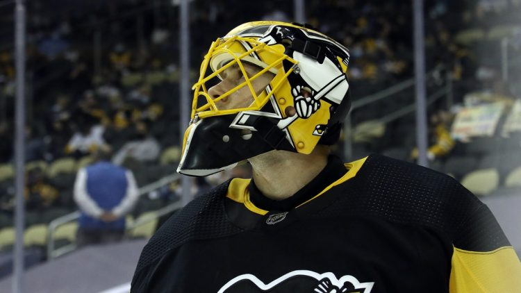 Apr 24, 2021; Pittsburgh, Pennsylvania, USA;  Pittsburgh Penguins goaltender Casey DeSmith (1) glances at the scoreboard against the New Jersey Devils during the second period at PPG Paints Arena. The Penguins won 4-2. Mandatory Credit: Charles LeClaire-USA TODAY Sports