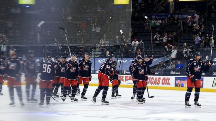 May 8, 2021; Columbus, Ohio, USA; Members of the Columbus Blue Jackets salute fans after defeating the Detroit Red Wings in the overtime period at Nationwide Arena. Mandatory Credit: Aaron Doster-USA TODAY Sports